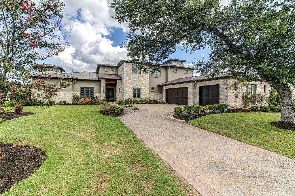 Fantastic greenbelt custom home, located in the gated community of Woods of Greenshores! This quiet community is just minutes from walking trails at Emma Long Park, and boating on Lake Austin.  This luxurious 5,400+sqft home sits on a .40 acres lot backing to a protected bird sanctuary. Professionally landscaped front to back, the backyard offers outdoor dining and entertaining with a covered patio, built-in BBQ grill, outdoor refrigerator, water featured swimming pool & spa, and irrigated tiered stone planters boxes ready for gardening. The downstairs offers a seamless indoor-outdoor lifestyle with vaulted ceilings and plenty of natural light. The well-appointed gourmet kitchen with center island, breakfast bar, commercial-grade, main and prep sinks, and dual dishwashers perfect for holidays and family gatherings, opens to one of many family areas in the home. The first floor also features the owner's suite, an inlaw suite w/ full bath, a designated office, a half bath, laundry room, and an oversized three-car garage. The owner's suite and bath feature a dual vanity, steam shower, separate soaker tub, and oversized his/her walk-in closets.  Moving to the second floor there are two more guest bedrooms each with a full bath, a separate half bath, a designated game room with dry bar, and a bonus room featuring an outdoor wood deck overlooking the greenbelt area. This property is a true hidden gem, just minutes from everything Austin has to offer.