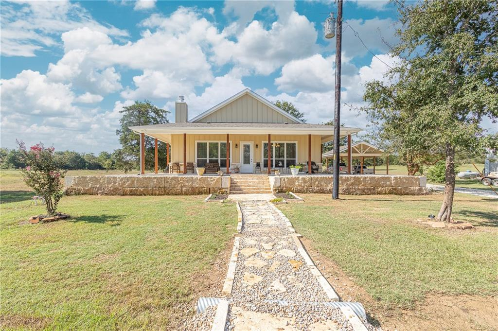 This rare custom built home on 12.3 acres is the private home of the builder Bennett Dev. LLC. The property is beautiful and referred to as the golf course by the locals. 750' water well used for irrigation and well water is piped across the property. Milam Co. water supplies the water to the  houses. 2 ac. pond is located behind the guest house and is beautiful during the rain season but pond holds water year around.  the barn is 30x45 with slab, electric and office, 2 bay doors and two work benches with electric plugs around total garage area. The two  homes on the property consist of a custom built beautiful main house, 4000' under roof and 2400' ac living area. The main Home features two master bedrooms with over sized baths and large walk-in closets with three rows of hanger and shelving. 10' ceilings with crown and trayed ceilings.  Vanities are level 5 quartz and double sinks in both baths. The living area and kitchen areas are enormous with 21' vaulted ceiling of Colorado Aspen tongue and grooved natural stained. Flooring is AquaGuard water proof and life time warranted. The fireplace in the living area is large limestone blocks with a custom cedar mantle with over sized fire box. Porches surround  entire home with 15'x40' pourch on back of home with ceiling fans and hot tub. The home is just 4 months old. The guest house is a 3 year old custom manufactured home with 1750 sq. ft, 3 bedrooms. Owners lived in it while building their home. Beautifully landscaped with decks on front and back of home. No kids, No pets, No smokers. The guest house is beautifully decorated and some of the furniture can go with the home. The property is ag exempt with honey bees. The bee  hives can go with the property as well. Kabota tractor with two mowers can also go with property. This is a turn key estate that is beautiful, fun and very functional. The second house can be utilized for guest or a great rental property.