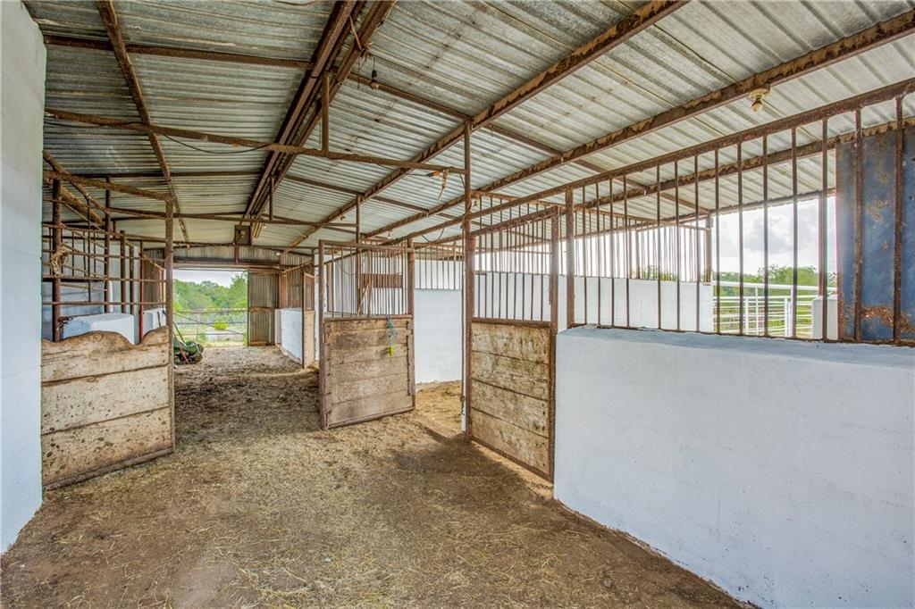 LOCATION! Minutes from Austin, Bastrop & Georgetown-country living with wonderful horse property.  This property features 2 ponds (one does go dry), a 32X46 horse barn with 5 stalls, a wash rack & tack room.  3/2 Double wide (like new) about 1340 sq ft, an older home with 3/2, huge carport for cars, trailers, boats, etc, 17X18 for hay, etc., 30X30 outbuilding and a 20x17 out building.  There are turn outs for the horses, cross fencing, GREAT area for an arena and much more.  This property is unrestricted and AG exempt.  Good grazing for cattle, horses, etc.  This is truly a MUST SEE property.