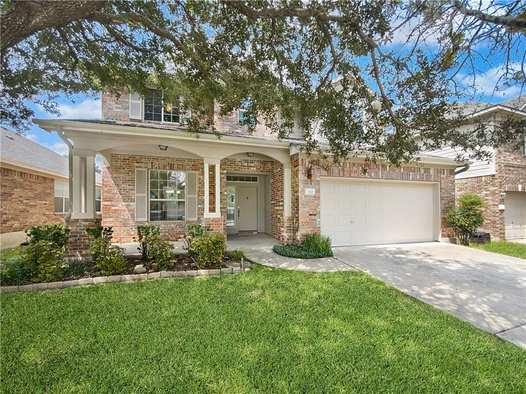This Round Rock two-story home offers a two-car garage.