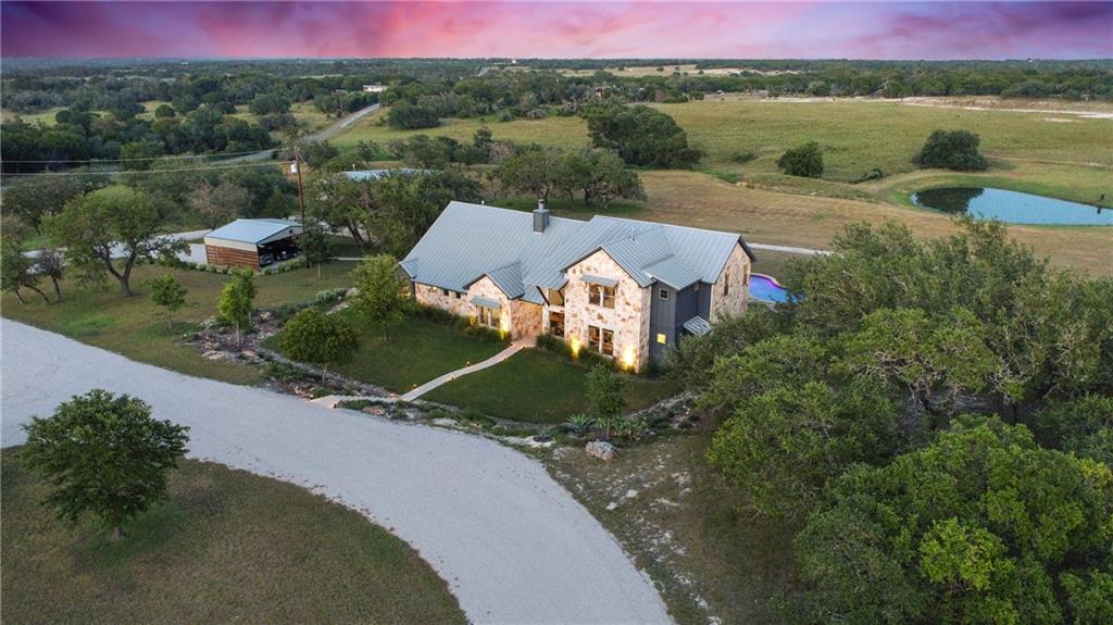The Double D Ranch is an impressive 186 +/- acre, high-fenced hunting and recreational ranch located just minutes from Bertram and Burnet and less than an hour drive from Austin. The ranch has been improved and managed with the utmost attention to detail. This move-in ready, turn-key showplace is ideally suited for family and guests to enjoy, whether hunting, fishing or just sitting back and relaxing while enjoying the views. A labor of love, the owner succeeded in creating an exceptional game ranch.  The whitetail genetics introduced to the ranch has created an outstanding whitetail herd producing bucks over 200 B&C.  Exotics on the ranch include Blackbuck, Axis and Fallow Deer.   This ranch has a well-managed habitat and a well-planned road system with feeder and blind placement to optimize the hunting.  Much of the cedar has been removed over the years, enabling the native grasses to thrive for wildlife. Starting at the custom-gated entrance a paved drive meanders a short distance to the 4700 Sq/Ft. Texas Stone home.  The main house features an open concept floor plan with plenty of east-facing windows designed to take in the hill country views and the flagstone patio and in-ground pool.  The 2-story home has 4 bedrooms (master and one guest down) 3 baths, a downstairs office and 2 first floor living areas.  This immaculately maintained home. Call for your private showing today.