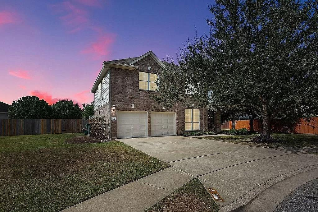 This elegant and spacious 5-bedroom, 3-bathroom, 2 story, single family home is located at the end of a long cul-de-sac in the master planned Falcon Pointe community. Special features include: a huge ~1/3 Acre lot with beautiful, mature live oak trees; large extended patio; tin roof pergola with ceiling fan and café lights; granite counter tops; engineered wood flooring; floor to ceiling tile in bathrooms; and a wood burning fireplace. New carpet and full exterior / interior paint in August 2021.