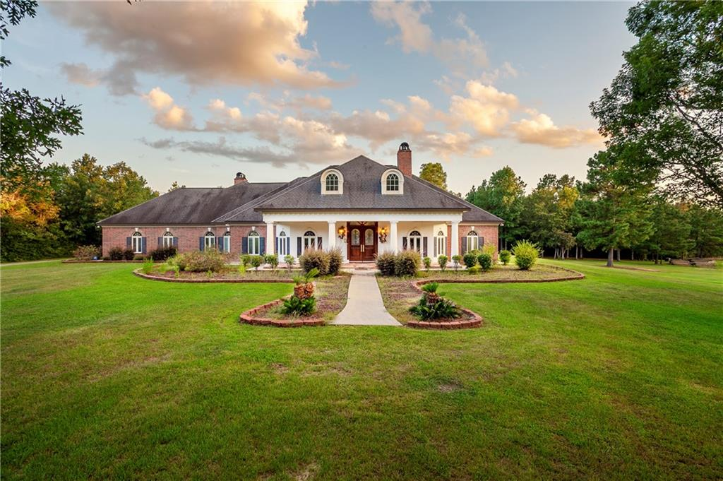 Set among the Piney Woods of Southeast Texas, this luxurious recreational ranch is privately located off Farm to Market Road 256. Drive up the paved, winding driveway, past the pecan orchard to find this beautiful 4300+ home sitting on hill, full of southern charm. Home features stunning, quality craftsmanship throughout. Entering in through the formal entry, guests are welcomed into the grand living room with views of the oversized, covered patio which includes a pergola. This ranch offers 167+ acres, 20+ of cleared, pasture. The remaining 140+ acres are heavily timbered with well maintained trails running through the property. New manufactured home on site for guests or your caretaker. Property also has 40'x80' meal shop with overhangs, 3 livestock shelters, fencing, live stream fed pond, game plots and so much more.