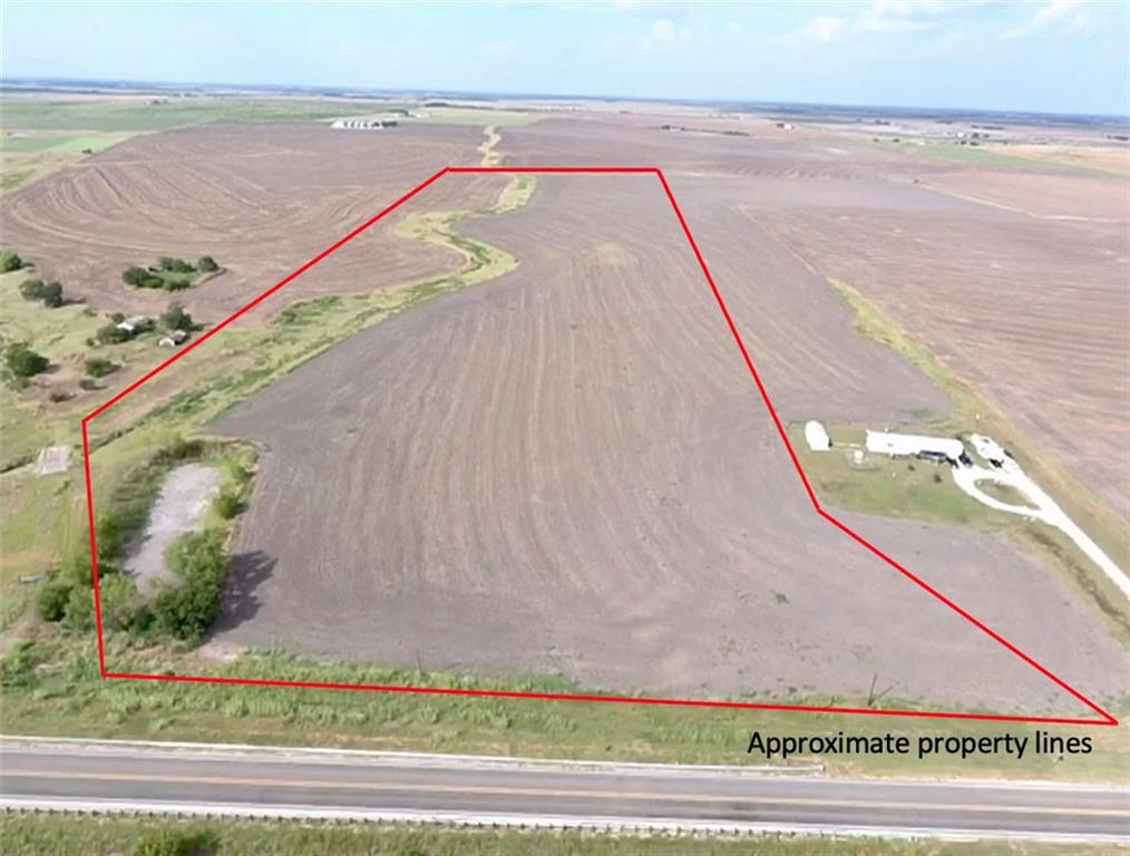 Country living! Beautiful agricultural land located 2 miles from Downtown Granger. Approximate 500 feet of paved road frontage on FM 971. 15 minutes from booming Taylor TX. Opportunity Zone! Buy as an investment or build your dream home and bring your animals. Bell Milam Water Supply and Oncor Electric available at the street. Seasonal wet weather creek on the property. Taxes are low with ag exemption in place. Ag lease through end of year.  No restrictions! New survey is being ordered.