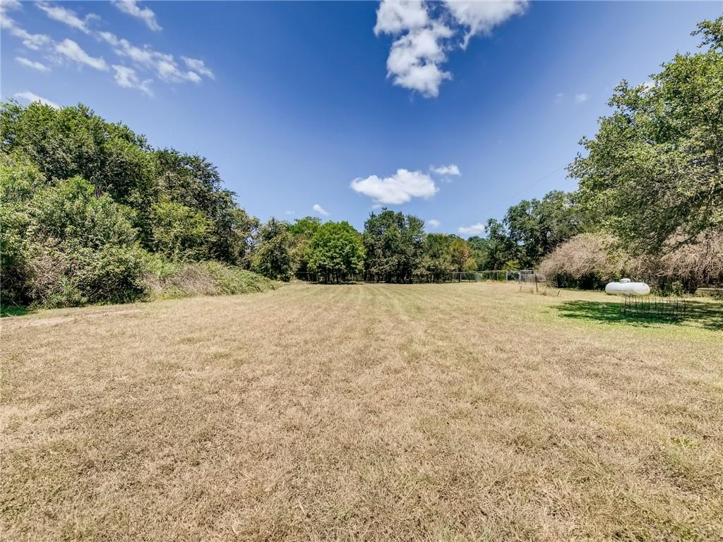 Own a little slice of heaven in San Leanna Estates in south Austin just 1.5 miles west of I-35. It is gorgeous out there!  This is a great .67-acre lot!  Flat, grassy, mostly clear, but still has lots of great trees. Ready to build on or use for horses, goats, and other livestock - or both. While this property description and offer price are for the lot pictured, the Owner is also selling an adjoining (separately platted) 1-acre lot that includes a 5bed/3bath house. Act quickly if you want to make an offer on one or both properties.