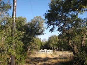 Beautiful 4.964 acre lot with private drive and trees galore. 3,000 sqft unfinished home is ready for a new buyer to finish out. Great spot for someone to live and work, clients in the middle of town with tons of elbow room. Build shop, storage garage, etc... HURRY WON'T LAST LONG! No restrictions and City Utilities, WOW  It is possible to rezone as commercial, however, it will be very expensive due to the City's requirements.  Can be used as Residential with a business if it is your homestead.