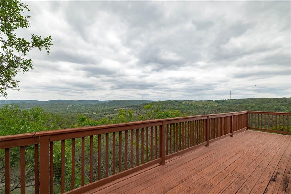 SPECTACULAR Hill Country Views!!! You'll feel on top of the world in this unique mountain top home that showcases fabulous hill country views from all 3 levels. Enjoy the breath-taking scenery from the wrap-around deck or from a stunning sunroom with vaulted ceilings and 2-stories of windows! This home has multiple indoor living areas, including an open kitchen/dining/living room and viewing/sunroom on the main level, and a family/game-room down. All of this and still close to town! Easy access to 1431 to Cedar Park and pick up 183 from there for your commute to Austin.