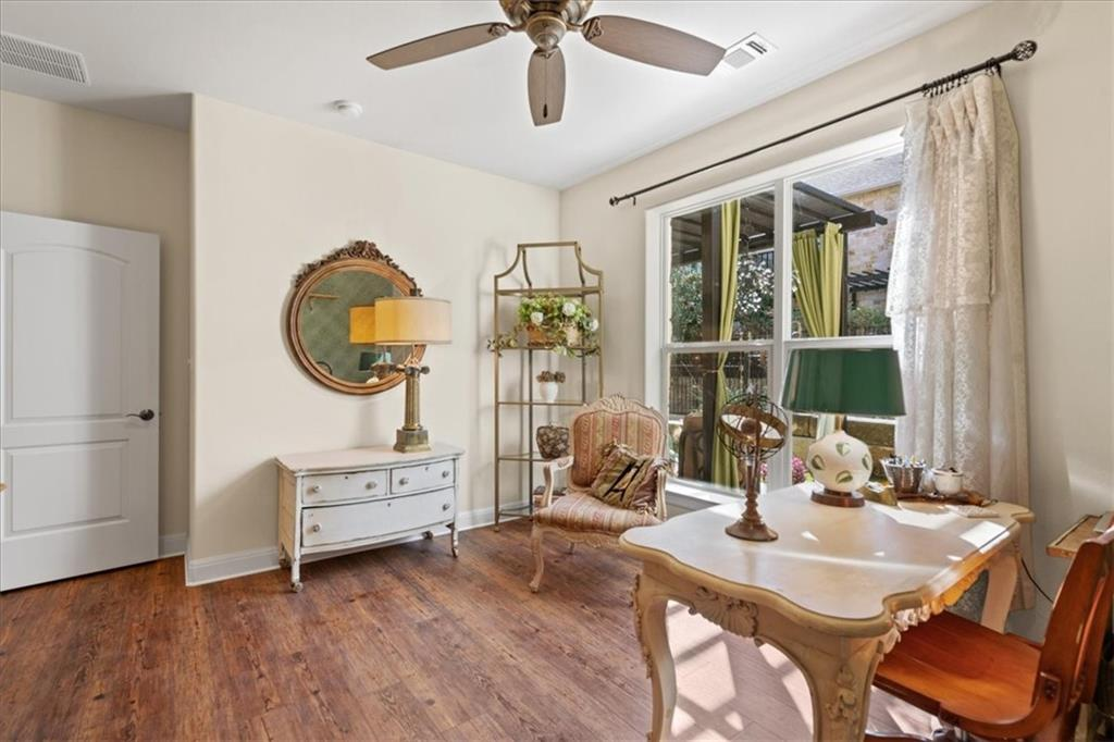 Located just a quick quarter of a mile bike ride or walk from Southwestern University, this condo boasts of high-end finishes throughout. From the Travertine floors on the entry-level to the matte granite countertops, custom window treatments, and wood flooring on the second level, the care given to the design of this home is apparent. On the first floor, this condo offers a guest room and full bathroom as well as a sunroom with views of the beautiful landscaping. The main living area, on the second floor, provides a unique amount of privacy for the homeowner to enjoy the comforts of this stylish home to the fullest. This stunning home allows it's next owner privacy, an upscale living experience, and proximity to all that downtown Georgetown has to offer!