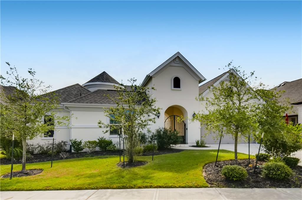 Click the Virtual Tour link to view the 3D walkthrough. Show stopping home with beautiful details from top to bottom! To enter you walk through a courtyard followed by a foyer right inside the front door. The open floor plan allows for an abundance of natural lighting to pour into the home. A two-sided fireplace connects the dining room to the family room. Through the family room windows you see a covered patio and a wide open backyard. Plenty of room for everyone with 4 bedrooms, 3.5 baths, 3 car garage and a large bonus room upstairs with a half bath and closet for storage. Primary bedroom on main level accompanied by a large en-suite and a walk-in closet.