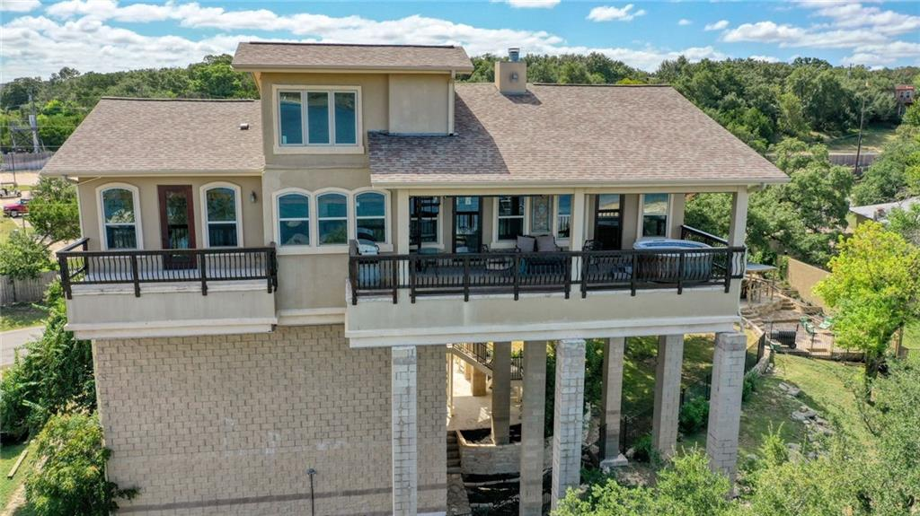 Waterfront! One of a kind elevated floor plan in the trees. Panoramic Lake Travis and Hill Country views from all sides. Located on the South Side of the lake,  close to shopping, great food, and entertainment. Outstanding nationally recognized schools. Mother in law plan with a great open flow. Amazing upper level patios, bonus room in the crows nest for yoga, office, work out 111 sq ft not show on tax record. Small cabin with two bunks, multiple areas for entertaining. Boat Dock Allowed. Fully furnished. Washer Dryer and fridge are all included. Great Vacation Spot or Short term rental. No rental restrictions. Deed allows for commercial use.