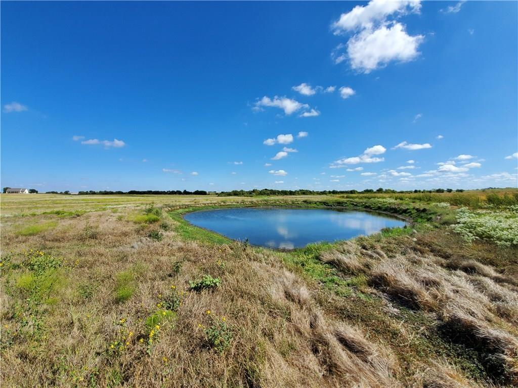 Don't wait, This lot is perfect for your home! No restrictions! Water by SW Milam @ road. Electric by Oncor @ road.  Survey provided by Seller. Lovely small creek @ back of property. Great soil for crops or livestock.