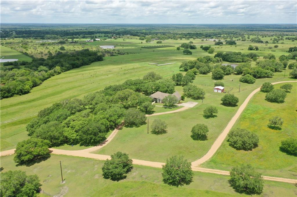 Come see the beautiful countryside of Fayette County! Approximately 1/2 mile off of FM 609, the custom country home is nestled between great oak trees. Enter into the great room that is fit for gatherings of family and friends. This area flows into the breakfast area and kitchen, which has plenty of counter and cabinet space. The home has a split plan with the grand primary suite on one side and the two secondary bedrooms and bath on the other. The primary suite features a garden tub, walk-in shower, and a large walk-in closet. Above the garage is a finished out bonus room that gives the home extra potential as either an upstairs game room or another bedroom. The backyard deck offers additional space that is perfect for entertaining or just taking in the view of the oak trees. The property features a nice barn and over 15 acres of beautiful countryside. Whether you are wanting to have some livestock or just wanting a getaway, this property is for you.