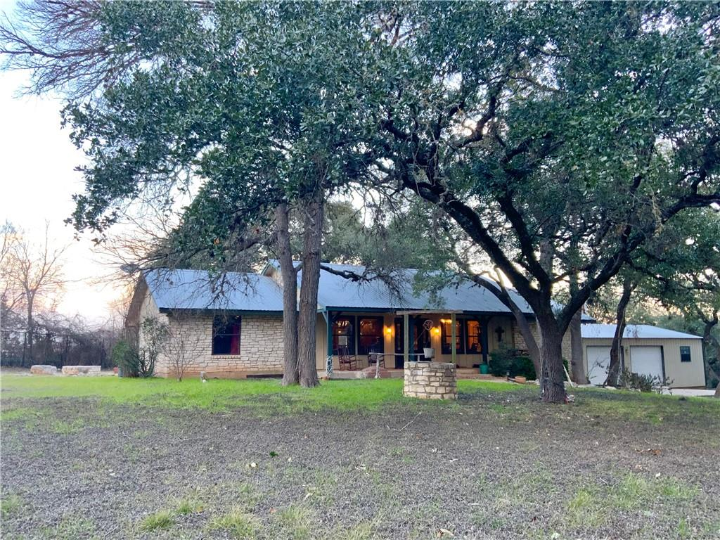 Picture driving onto a ranch and then a winding road  crossing the creek twice then pulling through your gate!  That is this piece of Texas you can call home and it has a pool for the hot summer days! The home also has a  full oversized guest bedroom w/bathroom and  privacy at rear of house. The main house is two bed and bath on left; Master with updated bathroom on the right and the big open ranch style living ,dining & Kitchen in the middle.  Did I mention the Oversized garage/workshop built for all your outdoor toys. Tree filled Lot.  Well house , shed & Chicken Coop. Back yard has a grand tree shading the decks with the large pool and firepit.  True Texas Style Home.