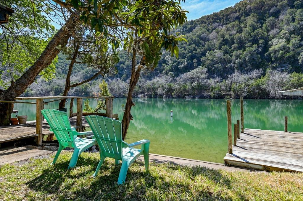 OPPORTUNITY ABOUNDS ON LAKE AUSTIN. Rare opportunity on the shores of Lake Austin with +/- 50' of waterfrontage. Sitting on about a quarter-acre, the existing cabin is to be sold as-is for a new owner or builder to make their own project. Property is situated on a lot overlooking a city preserve and includes a covered single slip boat dock with sun deck. Neighboring attractions include Lake Austin Spa Resort, which is just .5 miles downstream, Lakeland POA Park with a dock and boat ramp, and Quinlan Park with a public boat ramp. Zoned to Leander ISD schools including River Ridge, Canyon Ridge, and Vandegrift. Some photos have been edited to remove owners' personal items. Owner is licensed Texas Realtor. Exterior showings only with 24-hour advance showing notice required.