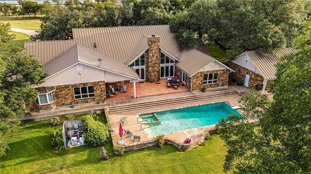 This 4,280 sqft single story ranch style home was built in 1996 using native San Saba stone and is set among towering legacy oaks. The home features an open floorplan with four bedrooms, 4 baths, vaulted ceilings and large windows for abundant natural light and sunset views. Next to the home is a great workout room with a large porch overlooking the pool and pastures, and a pool bath. There is an additional apartment over the carport for guests or rental income. Sunsets around the pool are stunning and private. This home can be purchased separately as part of an approximate 83-acre tract, or as part of the whole ranch.   Ranch Improvements:  A nice set of pipe working pens is located at the center of the ranch is capable of handling a lot of cows or stockers. There is a 75'X50' pole barn for parking equipment or dry stacking hay, and a 50X35 workshop for tools and storage. The ranch is completely fenced and cross fenced for rotational grazing and farming. There are waterlines and troughs in each pasture.   Water and Utilities: The property is served by San Saba Water Supply with meters to the house and barn.  The Sellers have a deeded shared water well agreement with a neighbor for livestock water.   Agriculture and Wildlife Highlights:  Rafter Cross Ranch offers a great mix of income production and recreation. The fertile soils are farmed annually and consistently produce healthy crops of hay and winter wheat. The ranch grazes equally as well and is capable of running heavy numbers of cow calf or stockers.   Wildlife is abundant along the river, with healthy populations of whitetail deer, feral hogs, Rio Grande turkey and migratory game birds.   Easements and Access:  The AT & SF Railway transects the ranch from east to west, but the short track has not been used in years. A ceased-use declaration has been filed.