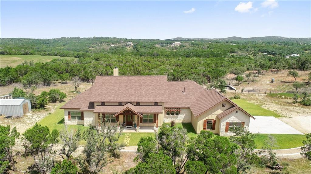 Enjoy your own Hill Country Estate located on over 14.9 acres in Dripping Springs.  Amazing hill country views from this gorgeous custom single story home built by Nalle Custom Homes, featuring a open floor plan and outdoor space which provide a perfect setting for entertaining guests.  Living room features vaulted ceilings, wood burning fireplace, and sliding doors open to your covered patio. The floorplan includes four bedrooms, three and one half baths, a dedicated office, and family room. Enjoy cooking and entertaining in the custom kitchen with silestone countertops, custom cabinets, and stainless appliances.  Property is ready for you to bring your own horses, goats and chickens, fully fenced and crossed fence.  Wet weather creek runs through the bottom corner of the property. Seller is on third year of qualifying for an ag exemption. Conveniently located 15 minutes to Dripping Springs and 20 minutes to Bee Cave.  Zoned to the highly acclaimed Dripping Springs ISD.