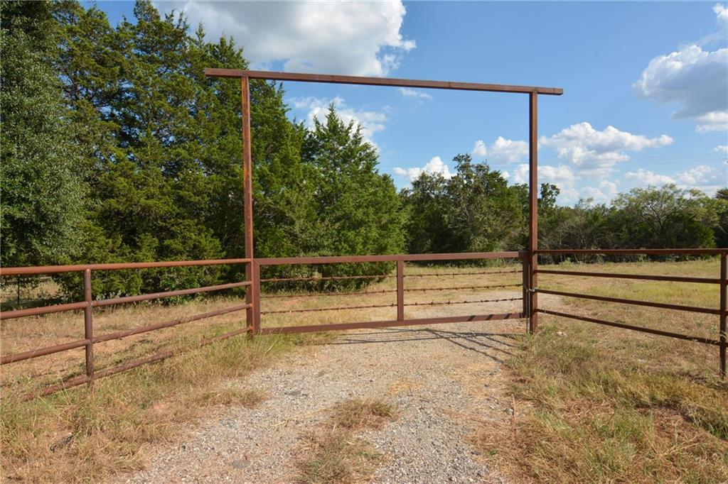 Beautiful 16 +/- acre property with a gated entrance on HWY 21 between Bastrop and Paige. With close proximity to HWY 290, puts this property in a prime location! Endless possibilities ensue for this unrestricted land, whether it be residential, farm and ranch, commercial, etc. This property is ready to go with water and electricity both available. Let your imagination run wild! Additional 16+/- acre tract available for purchase.