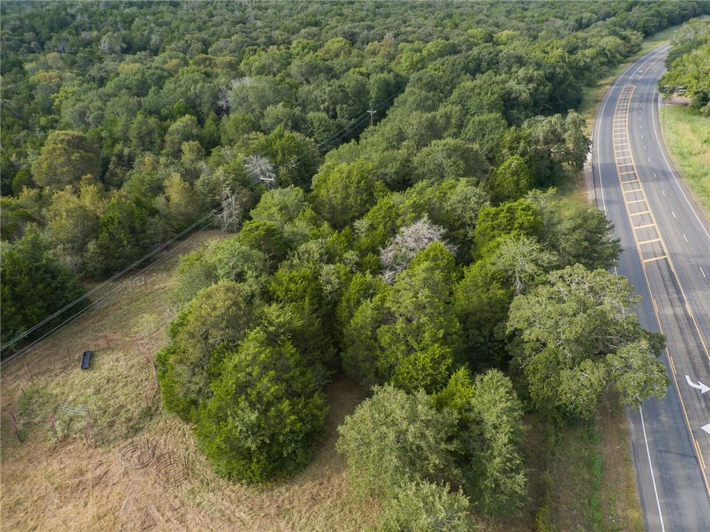 Beautiful 16 +/- acre property on HWY 21 between Bastrop and Paige. With close proximity to HWY 290, puts this property in a prime location! Endless possibilities ensue for this unrestricted land, whether it be residential, farm and ranch, commercial, etc. Let your imagination run wild! Additional 16+/- acre tract available for purchase.
