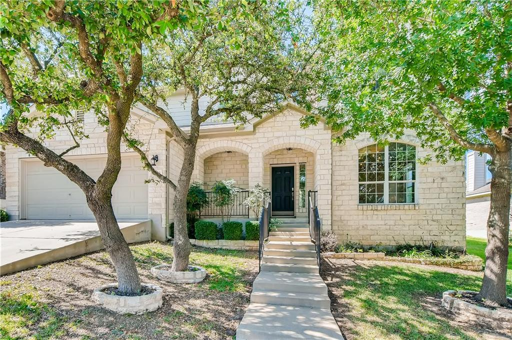 Visit this amazing 4 bedroom, 3 bathroom house loaded with beautiful features! Located in the coveted neighborhood, The Boulders at Crystal Falls, the home has a lovely curb and drive-up appeal. Enter the house and be greeted by quality brown wood-look flooring that takes you through the study with modern French doors and into the living room. Sit back and relax in the living area with a corner fireplace and large windows for natural lighting. The upgraded kitchen is next to the living room and highlights granite countertops, classic white cabinets, stainless steel appliances, and a gas stovetop! On the second floor, you will find the primary bedroom has bright lighting, a spacious layout, and an en suite bathroom. The bathroom features a garden tub, dual sinks, a separate shower, and a walk-in closet. Wanting to plan a fun activity for your guests? Do it in this oversized yard and when you're too tired from the heat, retreat onto the covered patio! The house is conveniently close to the community pool, less than a 5-minute drive to the Gateway Shopping Center at Leander, where you'll find all your favorite stores.