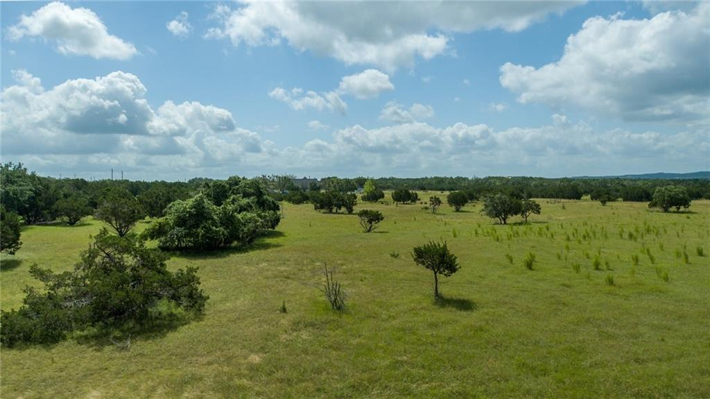 14.836 +/- acre lot to be subdivided in the heart of Dripping Springs and the Lone Star State's beloved Texas Hill Country. Lot can be subdivided into parcels as small as 5 acres. Ideally located on a quiet and private road, a few minutes from the highly desirable West Fitzhugh & Bell Springs Road. Beautiful pasture views, flat lot and mature trees. Great for horses. Minimal restrictions. Residential only. Fenced on three sides. New 3-Rail Horse Fence to be installed separating lot from neighbor's newly built farmhouse. Perfect lot to build your custom dream home. Dripping Springs ISD. Lot is agriculturally exempt, offering very low tax rates. Cattle have been on the property for many years offering great soil. 4 Minutes to Texas Hill Country Olive Company & 12 Fox Beer Company. 14 minutes to Mercer Street in Downtown Dripping. 24 Minutes to Hill Country Galleria. Sign on property in front of lot available. 4 Bedroom/3 Bath house on 10 acre side is being remodeled and will be available for lease.