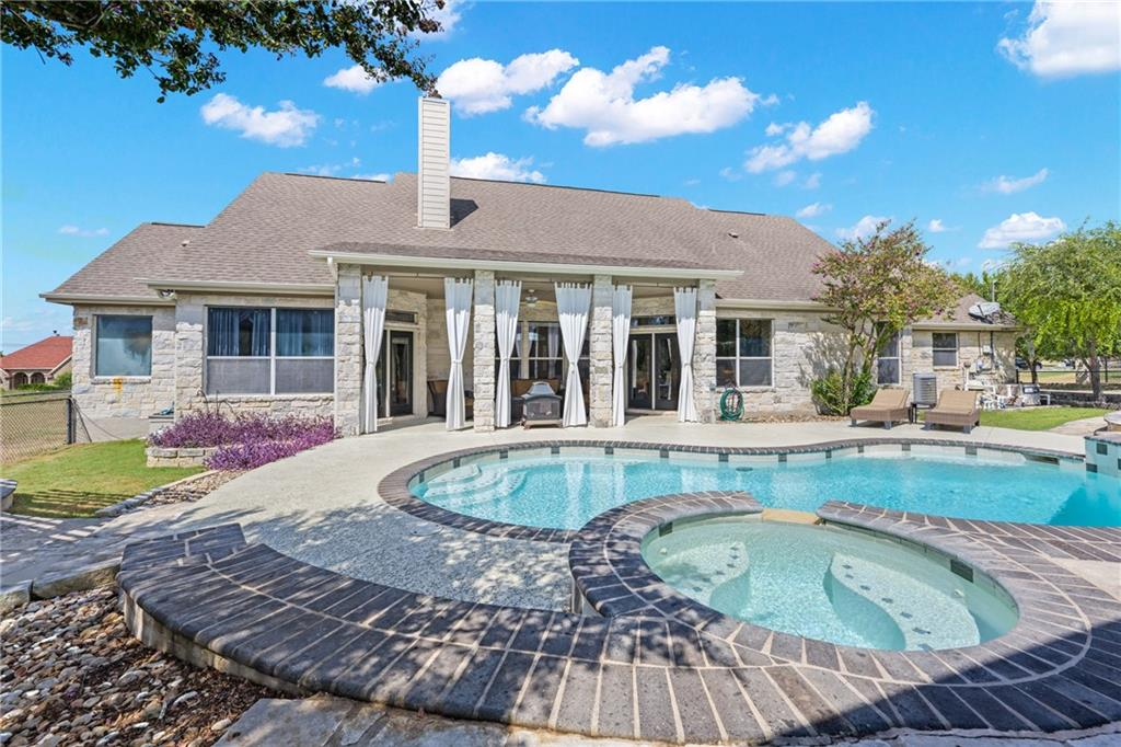 An Entertainer's Dream situated on 3+ acres just minutes from Lake Georgetown!  Welcome to 131 Landons Way, a luxuriously finished home that features an AMAZING backyard oasis, comprised of 2,900+ square feet (owner) of extended outdoor living space, complete with a heated pool w/ spa, a 30' X 30' covered cabana (which includes an outdoor fireplace), a nice outdoor grill area with beautiful pergola and a covered back patio.  The PERFECT spot to relax on a summer day or host stunning evening events!  There are views of great Texas sunsets off of the front porch as well!  Too hot outside?  Then step into the decadent flex space inside!  The flex space features TONS of custom soft-close cabinets and drawers for storage, a wet bar, granite counters and HUGE custom center island with a granite top.  This space can accommodate parties and is great as a game room/craft space. The main living space of the home has a bright, open layout that has plenty of natural light from the large rear windows and an inviting stone fireplace.  The kitchen is open to the family room and boasts granite countertops, stainless steel appliances, a breakfast bar and a breakfast  area. There are 4 bedrooms and 3 full bathrooms plus a study, great for anyone working from home.  The primary suite has access to the back patio and features dual vanities, walk-in closet, separate shower and a jetted tub. The layout is completed by a formal dining room, a laundry room and 3 guest rooms.  There are LOTS of upgrades throughout this home.  The home is move in ready and has easy access to Lake Georgetown at Russell Park (about 3 miles away).  The home offers a private feel, with convenient access to shopping, I-35, Fort Hood, 130 toll and the Austin airport.  A truly unique home packed with all the features for a once in a lifetime living experience!  Truly one you won't want to miss! FEMA Unknown.