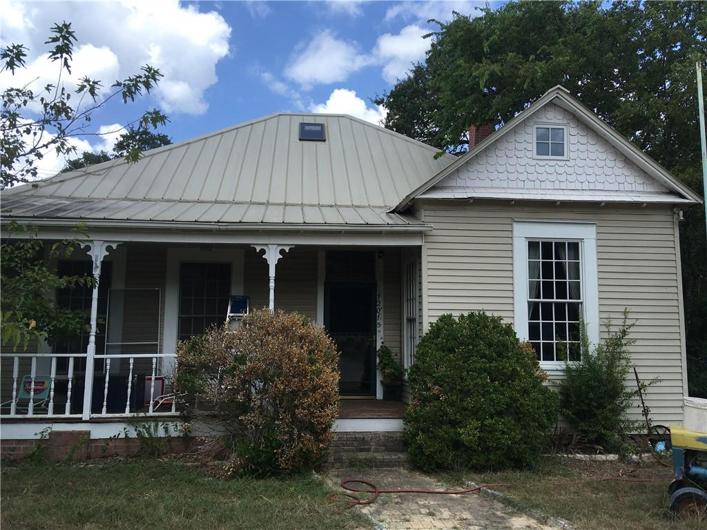 Quiet, but close in with extra acerage. 1 acre fenced for dog and children. Metal roof, All Pella windows, tongue-in-groove wood floors, cherry cabinets, granite countertops, 10 foot ceilings. NEW SURVEY OF PROPERTY JUST COMPLETED. Private Water Well. Large covered Porches.