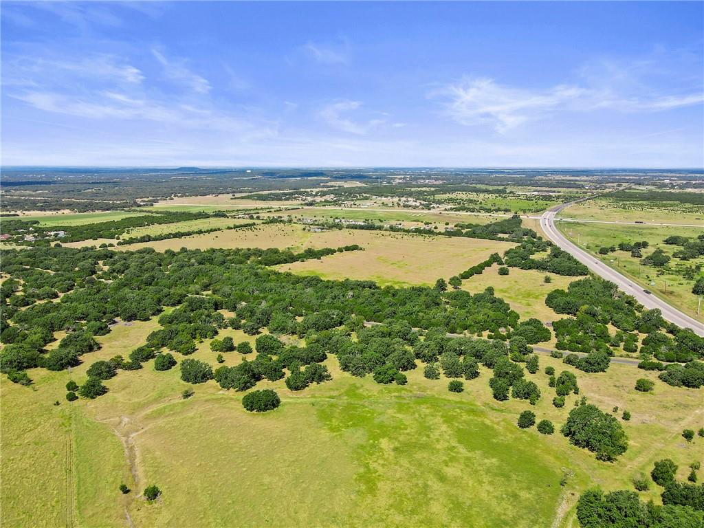 Atkinson Ranch at Rocky Hollow is a premier sizeable property located on Williams Drive near Ronald Reagan Blvd., and minutes from downtown Georgetown. This legacy working cattle ranch is nestled in between the communities Gabriel's Grove, North Lake and Parmer Ranch and is waiting to be developed into an exceptional community. Rolling terrain and plentiful legacy Liveoak trees make the ranch perfect for luxury homesites.  Ranch consists of three parcels of land, 301 acres, 41.56 acres and 77.98 acres. Only the 301 acres and 41.56 acres are being offered, but the additional 77.98 acres is negotiable. All located on the south side of Williams Dr. The 301 acres and 41.56 acres are connected. The 77.98 acres is located across Indian Springs Rd to the west and toward Ronald Reagan Blvd.  Limited to the imagination of what could be at Atkinson Ranch at Rocky Hollow.   Close all gates. Cattle on property.