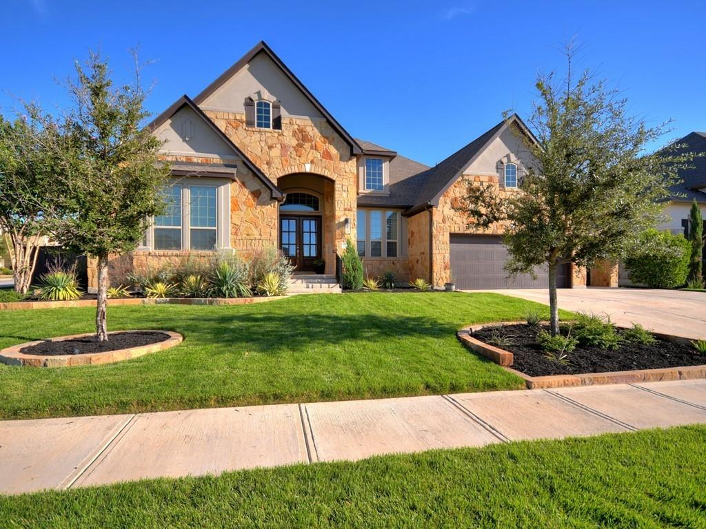 Spectacular single story with sparkling pool and spa and over $200K in upgrades! Bathed in natural light, this extraordinary home takes your breath away the minute you walk in! Quality abounds! The beautiful double doors open to an extra wide entryway featuring dual Restoration Hardware lighting. There are custom window treatments throughout, including automated shades in the primary bedroom and gameroom.  The gourmet kitchen with large island is open to an amazing family room with views of the pool.  Enjoy a relaxing retreat in your spacious primary suite including luxurious bath and huge closet.  A 2nd living area can serve as a kids playroom or a large gameroom with plenty of space for a pool table and shuffle board.  French doors lead to an office complete with a hidden bookcase storage area.  Venture outside to your large covered patio and enjoy resort living in your own backyard! Indoor and outdoor speakers enhance the mood. Entertain friends or relax at day's end in your beautiful pool and spa with lighting, sundeck, and waterfall. The phenomenal landscaping package includes Zoysia grass and landscape lighting in front and back. The garage features epoxy floors and overhead storage. The 4th bay can accommodate a golf cart or a small sports car. This one story beauty is in a class of its own!