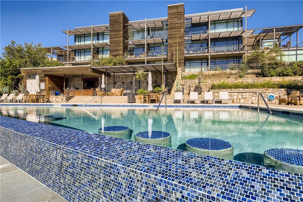 Exclusive lakefront Condo at Waterstone Condominiums on Lake Travis. This modern resort-like community was designed by famed architect Larry Speck. You'll be greeted by an open floor plan that is perfect for entertaining. You'll enjoy spectacular views of the hill country and Lake Travis through floor to ceiling windows on both levels of the home. Soaring ceilings and sleek design elements are present throughout. The kitchen is ultra-modern with granite countertops, stainless steel appliances (refrigerator stays with the home!), large sink and bar seating. The oversized master bedroom has a walk-in closet and modern ensuite bathroom with large soaking tub, shower and double vanity. A spacious second bedroom has a private bathroom and large walk-in closet. The covered breezy balcony has plenty of space for relaxing or dining while taking in views of Lake Travis. There is a detached 1 car garage. Just a short walk to the lake and amenities. Exclusive resident amenities include an infinity pool, generous spa, large sundeck, gourmet outdoor kitchen, fire pits, communal day slips and dock, lake swimming area, trails and more. Fabulous for a full time resident or lock and leave style lake life! **Fridge, Washer, Dryer, wine fridge, safe in master closet and coffee bar convey**