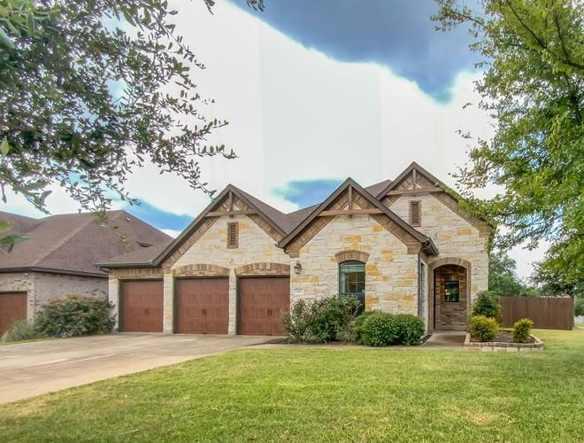 This Cedar Park two-story corner home offers granite countertops, and a three-car garage.