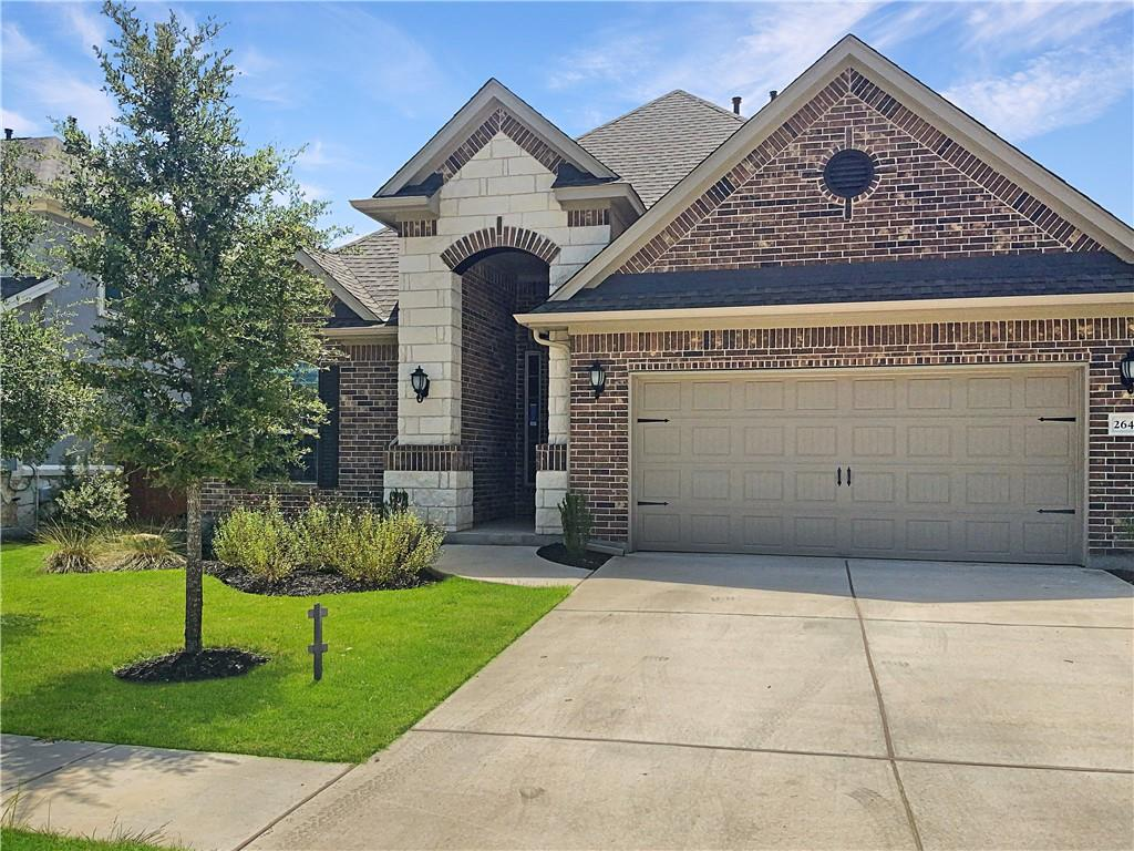 Built in 2018, this Round Rock two-story home offers granite countertops, and a two-car garage.