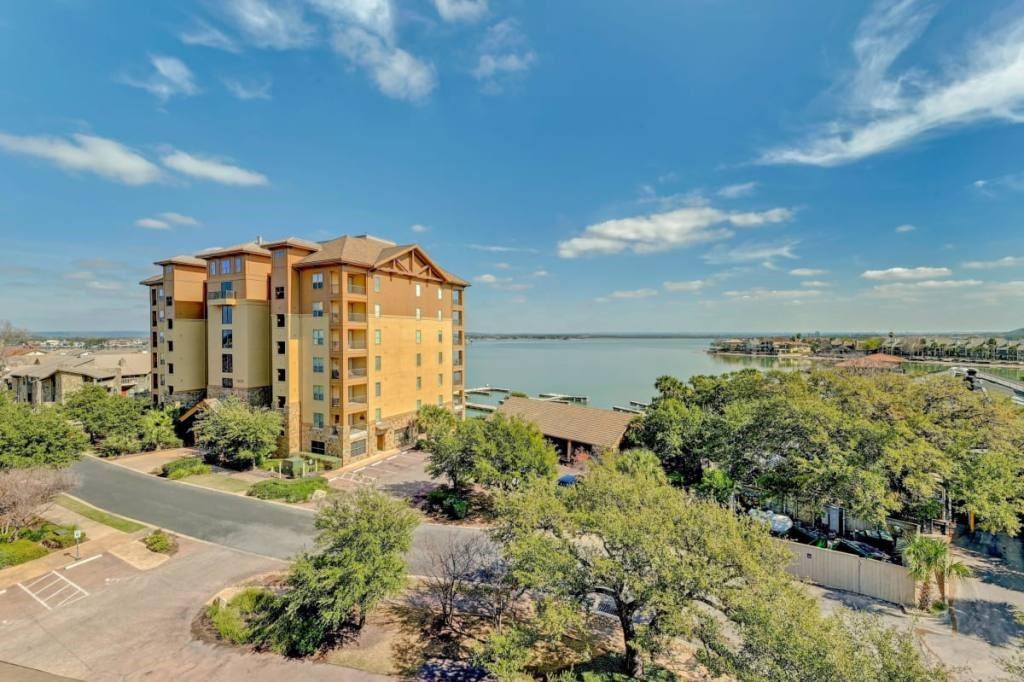 It's your chance to be in the heart of Horseshoe Bay with fantastic views of Lake LBJ!  Walking distance to the Yacht Club, HSB Spa, marina, restaurants and all that HSB Resort has to offer!  not only do you and your friends/family get to enjoy this well appointed condo but short term rentals are allowed!  The covered balcony is an awesome location to enjoy lounging, having a meal or just admiring the lake views.  Everything needed to enjoy lake life is in this turnkey condo!  Now is the time to make this your home or your home away from home.  Furnishings convey.