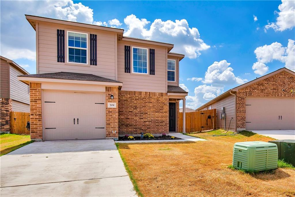 This beautiful home features an open concept floor plan with lots of natural light and an oversized back yard.