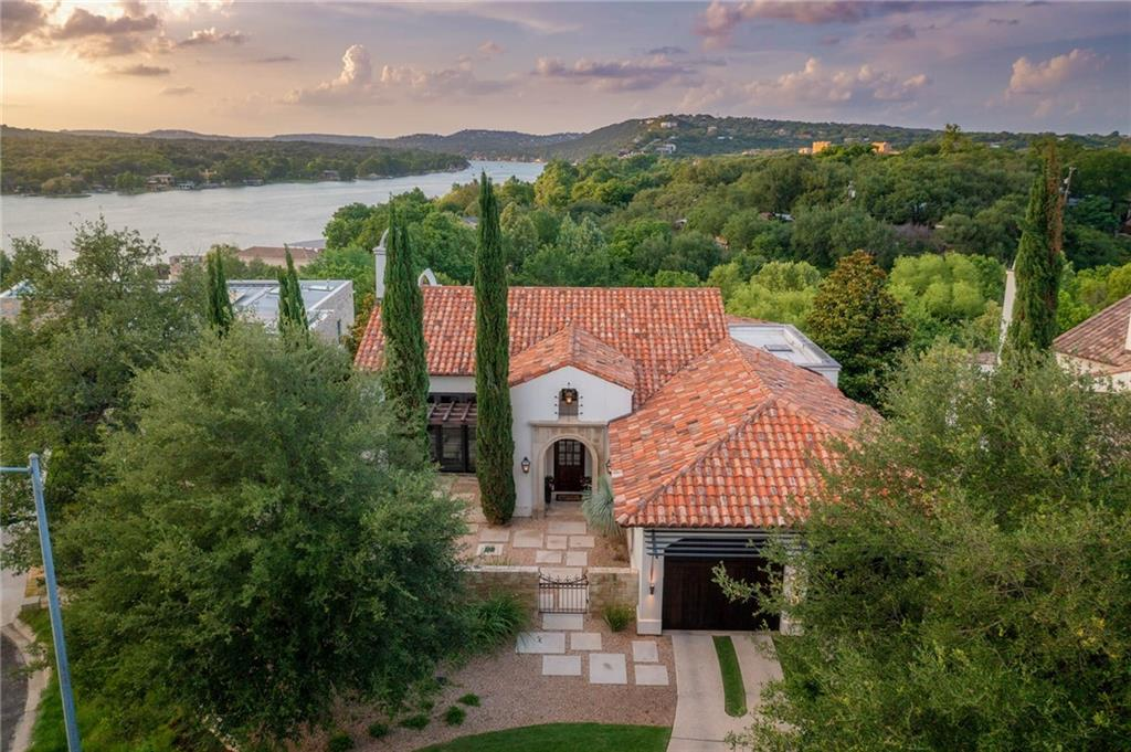 Rare offering in Tarrytown near Scenic.  Views from the gorgeous covered patio with Fireplace and pool-  Lake Austin and the hills beyond.  Ryan Street designed.  Michael Deane build.  2009.