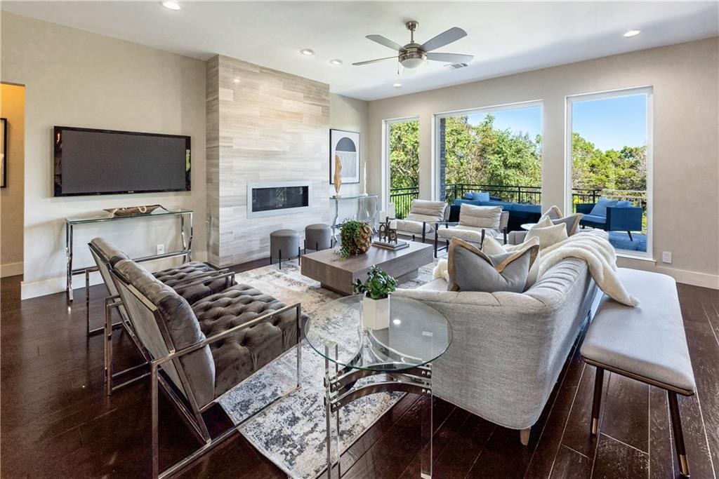 This transitional/modern home is located on a quiet a cul-de-sac in River Place and has it all! Excellent layout with the primary and a secondary bedroom on the first floor.  5 bedrooms PLUS an office. Lots of big windows to enjoy the natural light, windows are new from 2020. The kitchen has been beautifully remodeled with flat panel, walnut cabinets, subzero built-in fridge, wine fridge, Wolf commercial grade gas range with a griddle, double oven and 6 burners.   The master bathroom has also been remodeled with designer tile, flat panel walnut cabinets and lots of built in's. Huge primary closet with built in drawers, cubbies, counter top and lots of hanging space. Gameroom up with 3 bedrooms. Gorgeous views to the pool and green space in the backyard and upper views of the vast hill country. Great privacy. Resort style pool with a raised hot tub. Tons of outdoor lounging space covered and uncovered. Minutes away from the River place nature trail, one of the best hikes in Austin! Great community with excellent schools and location. See matterport for layout.