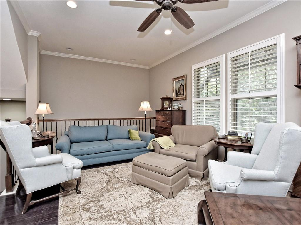 Elegant 4 BR, 3BA, 2 Half bath Townhome located in the Brownstone at the Summit community,Large trees and walking distance to many restaurants. Extremely well cared for home!  Special features: elevator, deluxe flooring and cabinets in garage, water softener, ring security cameras at front and back of home, bar on 4th floor, fireplace on 4th floor deck, built-in silestone 2 partner desk on second floor. High quality finishes, easy access to I 35.  This is a Must See Home!  WCAD is likely wrong and square footage is closer to 3000 sf.