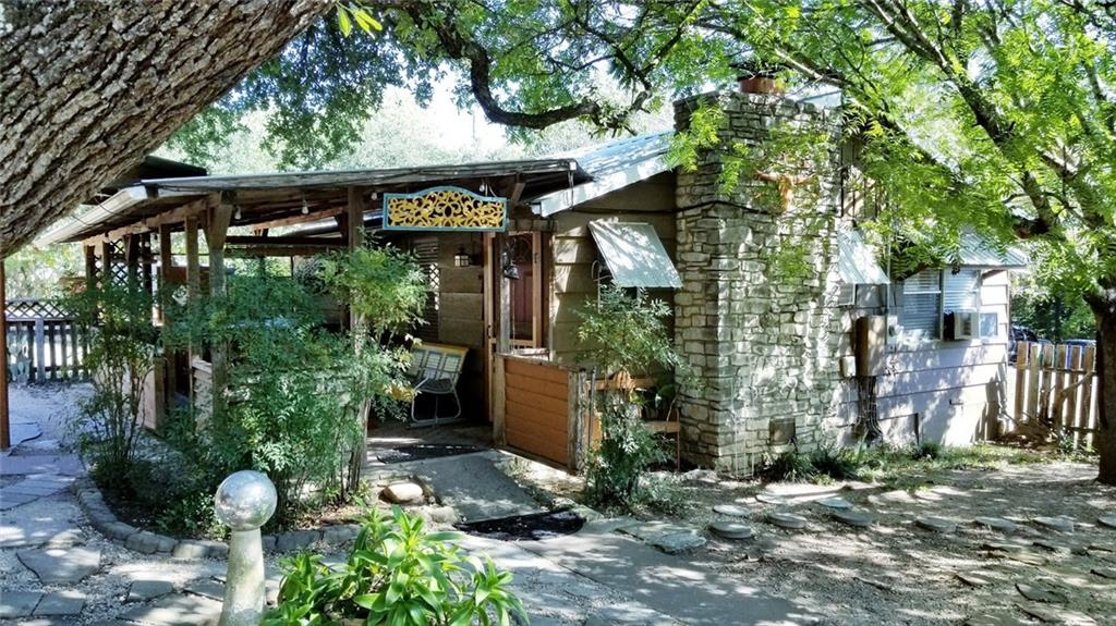 """One of a Kind Beautiful """"Hip"""" Hill Country Cottage with Adjacent Guest/Utility Room.  Patios, Decks, Covered and Uncovered Outdoor Living Spaces, Treehouse Deck, Storage Sheds, Workshop, Carport! All with 4 platted lots in Beautiful Natural Tree Shaded Setting! Super Efficient Inviting Interior Space with Cathedral Ceiling, Gorgeous Stone Fireplace with Propane Fireplace Insert, Ceiling Fans in Every Room, Full Bath, Super Cute Comfy Space! Exterior Adjacent Lots Fitted for RV Parking and Hook-Ups. Nearby Lake Access at Jones Brothers City Park Additional Lots are Great for your own Privacy and Elbow Room or Use to Re-develop in Hot Jonestown Market"""