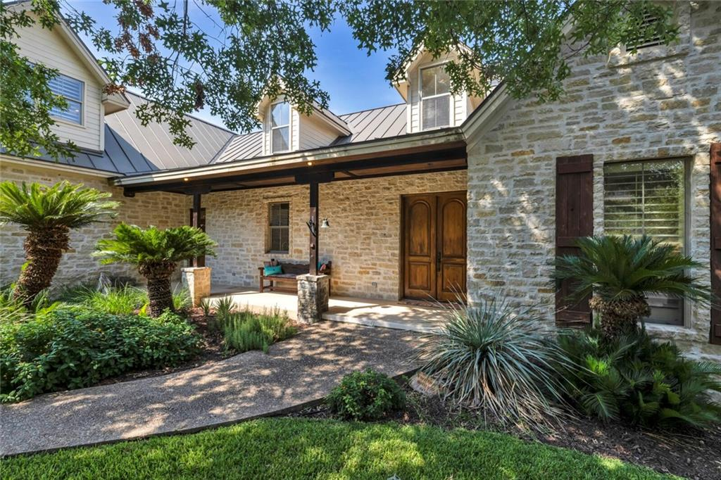 """This One-of-a-Kind Texas Hill Country Charmer comes with AWESOME PANORAMIC LAKE LBJ & VISTA VIEWS!! Spacious open kitchen/dining & living area with gas fireplace welcomes you upon entering. Your attention is immediately captivated by breathtaking views through a wall of windows. First floor has OVER SIZED master suite w gas fireplace...connected to laundry room for step saving convenience. Nice size guest bedroom & full bath is located on opposite side of first floor along with office nook. Kitchen is chef's dream with gas cooktop, stainless appliances, 2 pantries & plenty of counter space to prep and serve. House has abundant storage. Step outside to large covered Northern Exposure deck overlooking Horseshoe Bay & beyond. **Seller owns the lot behind which can be purchased to protect those precious views. Upstairs is a quiet sanctuary of 2 large guest rooms & a full shared bath. Wood bead-board ceilings upstairs add a special touch as do plantation shutters throughout the home. Need extra space for workout, art studio, woodshop or just plain STORAGE?? Look no further, an outside entrance BELOW house opens up to """"all of the above"""". Mini-split AC/Heater was added for comfort in this part of the house (not included in home's sq footage). Wooded private side yard gives you more room to enjoy nature with its park like setting on a peaceful cul-de-sac. Come, Enjoy & Decompress!"""