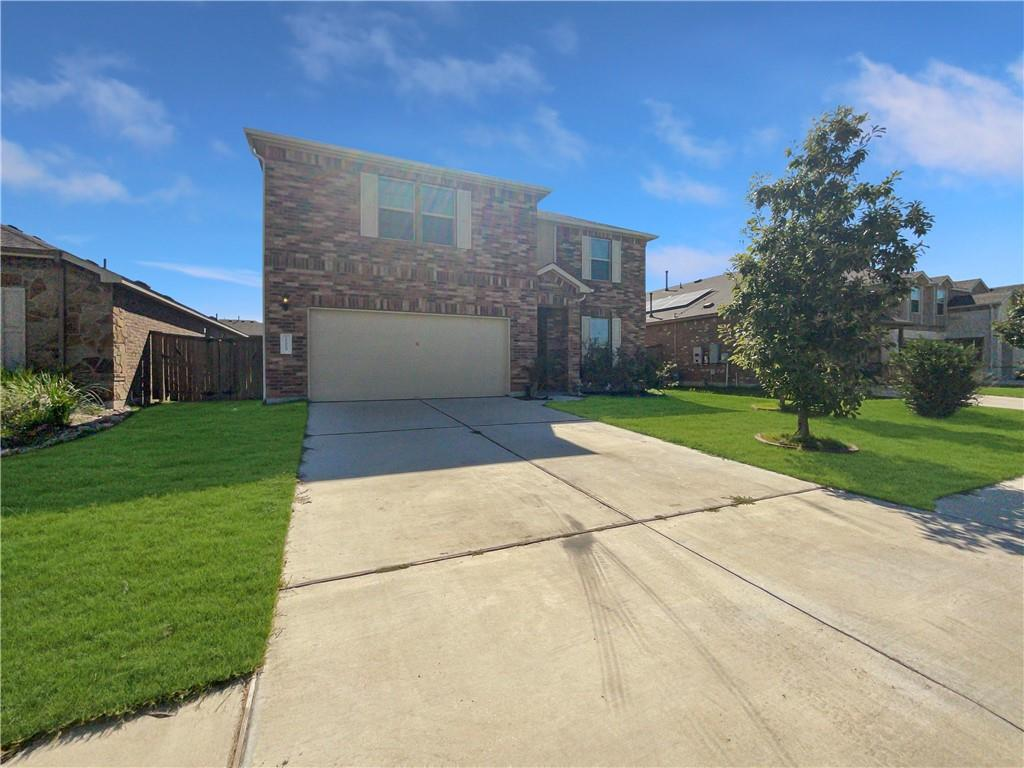 Built in 2016, this Pflugerville two-story home offers granite countertops, and a two-car garage.