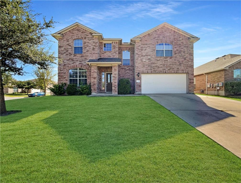This Pflugerville two-story home offers granite countertops, and a two-car garage.