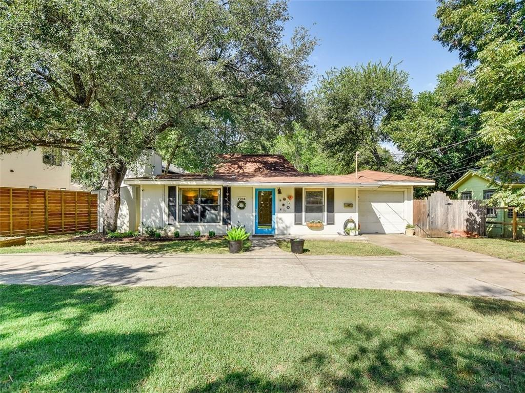 Adorable bungalow in Tarrytown backing to Johnson Creek. An amazing opportunity to live in one of the most desirable neighborhoods in Austin! Upon entering the home, you'll find the living room with a large, wood-burning fireplace, as well as a separate dining area. The kitchen includes Sile-stone countertops, stainless steel appliances, and an island for all of your meal prep needs. The light-filled bedroom off of the kitchen has great proximity to the living spaces and could also be used as a home office. You'll find another bedroom and the primary suite just down the hall. Hardwood floors throughout most of the home. Find your zen by escaping to your own quiet and private backyard! Enjoy the large deck and privacy that backing to the creek offers. A short walk away from West Enfield neighborhood park and less than one and a half miles from Deep Eddy's spring-fed pool. Zoned to an award-winning elementary school currently going through a fabulous remodel.  A new amazing H-E-B is being built in the neighborhood. Historic Public Golf Course very close by and many new homes being built on this street.