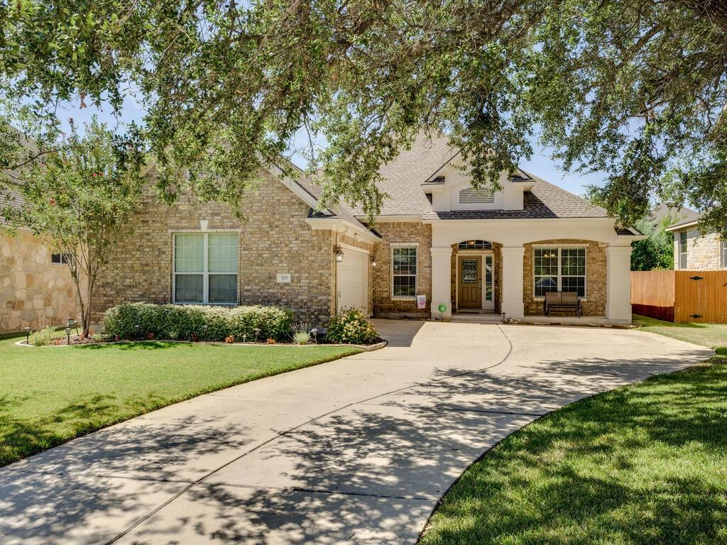 This Ranch at Brushy Creek beauty is sure to impress even the most discerning of buyers. Located on a very quiet street, this home boasts a 2 car garage, a meticulously maintained yard with updated grass and WiFi controlled sprinkler system and a shingle roof that was replaced in Aug 2014. From the moment you step inside, the feeling of warmth and comfort will wash over you. The floor plan is perfection with a seamless, open concept flow, 3 bedrooms, 2.5 bathrooms and a dedicated office. A stone fireplace sits in the corner of the spacious living room and provides a cozy ambiance on cool fall and winter evenings. The kitchen is absolutely gorgeous with wood cabinetry that harmonizes perfectly with the tile backsplash and granite countertops. Stainless appliances include a gas cooktop, built-in oven, microwave and dishwasher. This wonderful kitchen has also been updated with a new garbage disposal (2020) and dishwasher (47db, VERY quiet). The oversized owner's suite is the epitome of relaxation with a soaring ceiling, large bay window, updated ensuite bath (new sinks and faucets) and walk-in closet with a built-in ironing board. The 2 guest bedrooms are both spacious in size and feature high ceilings, plush carpet and tons of natural light. The informal dining area flows onto an outside patio, setting the scene for chilled-out afternoons during both the spring, summer and fall months and includes an updated wrought iron railing and a sun shade. Additional updates include HVAC (2017), Ring doorbell with camera and ring security light with camera over garage, 50 gallon gas water heater (10/20) with 10 year parts/labor guarantee and wired for security through Central Security. This wonderful home sits just down the street from Brushy Creek Lake Park which includes a lake, trails, playscapes and splash pad. Where else are you able to find a gorgeous home with so many great outdoor spaces just a few mins away? Schedule your showing before it's too late!