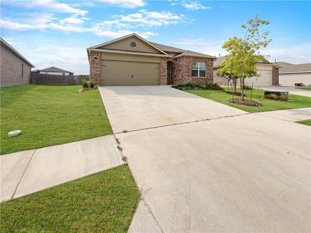 Built in 2018, this Round Rock one-story home offers a patio, granite countertops, and a two-car garage.