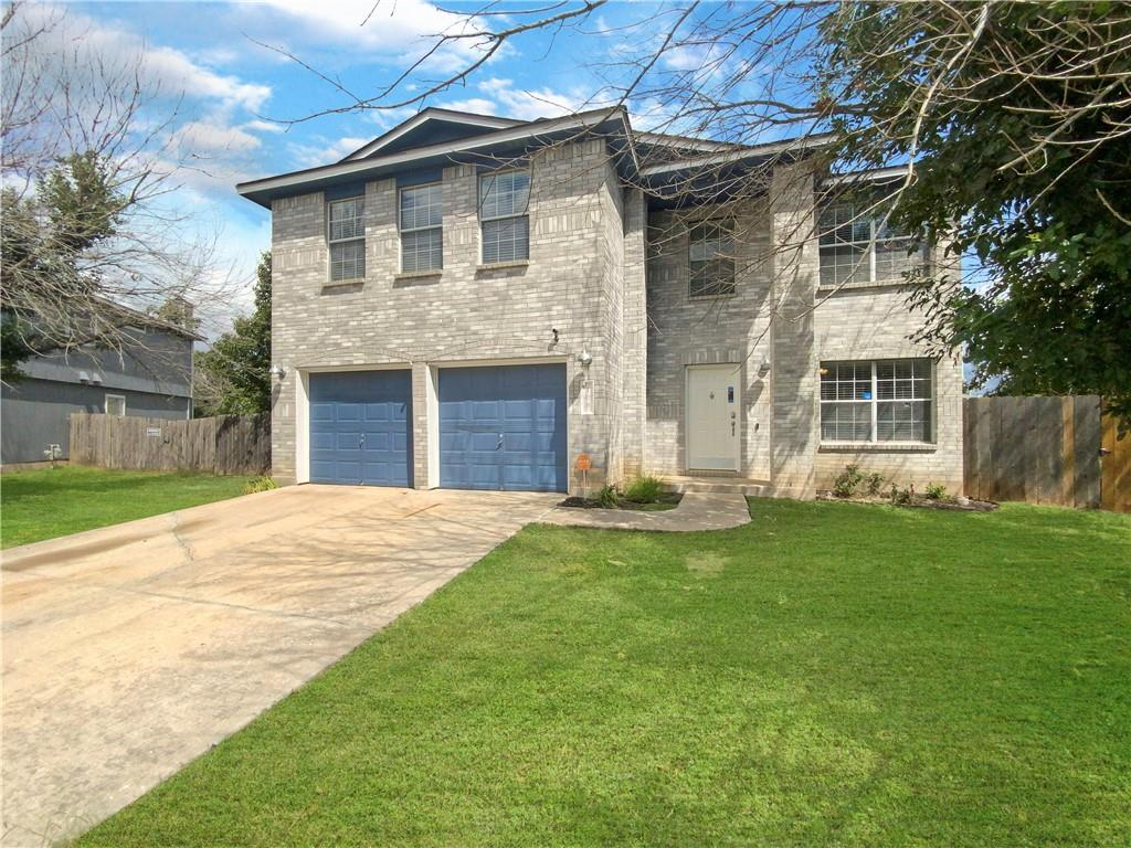 This Hutto two-story cul-de-sac home offers a patio, and a two-car garage.