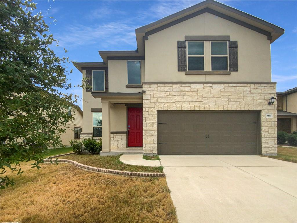 Built in 2016, this Round Rock two-story home offers granite countertops, and a two-car garage.