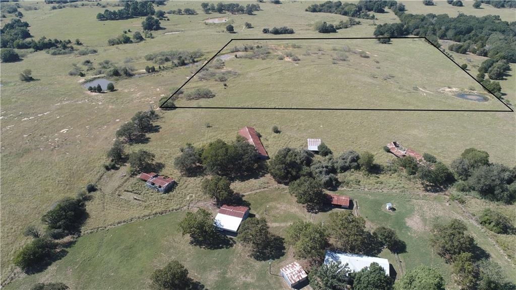 19 acres in Bastrop County! Adjacent available tracts for sale. This beautiful property is mostly open with 2 large tanks. Hurry! This one won't last long.
