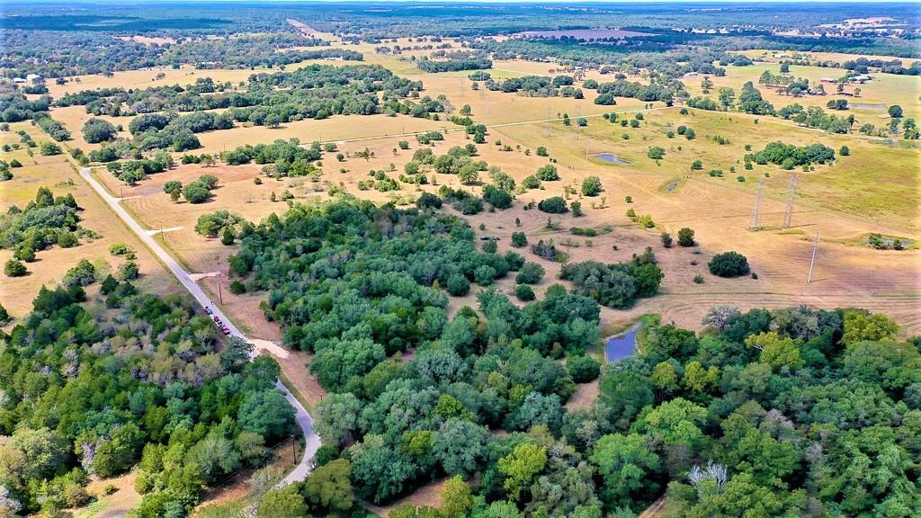 Rare 10.1050 acres ready for you to build or bring in your dream home! This lot is fully fenced with a new driveway, gate, culvert, electricity at the road and stunning, mature trees. Seller to drill water well or supply a $10k credit for a water well at closing. Double wide manufactured homes in new or like-new condition are allowed! Seller financing offered with as little as 10% down. Only minutes to Smithville and a very short drive to Giddings, Bastrop and La Grange. Less than a 45 minute drive to the new Tesla factory and the Austin airport, and 50 minutes to Downtown Austin! This land is perfect for peaceful country living with an easy commute! There are tons of activities in the area such as: hiking, biking, kayaking, fishing or boating in Bastrop, Somerville or Fayette lakes, camping in 2 State parks, and much more! Bring your livestock and start enjoying the easy-going country life. This property is currently ag exempt. Some light restrictions apply to protect property values. Other adjacent lots available! For further info see posted docs. Do not miss this opportunity - make an appointment to come check it out today! You'll love it!