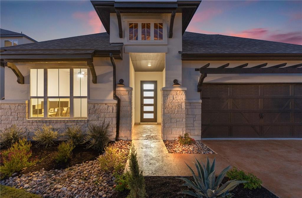 Basically brand new construction without all the hassle! This Drees home was just completed earlier this year and has been meticulously taken care of. No need to wait a year to build a home with a builder or deal with all the waitlists to try and get into the coveted neighborhood of Rough Hollow with all the amentities. Pools, Tennis courts, swim up bar, you name it! This home has all the upgrades and bells and whistles you could think of. Everything from European Spruce Hardwood floors, 14 Sonos ceiling speakers throughout, extended covered patio, oversized kitchen island, Marble floors in master bathroom, upgraded fixtures, soaking tub, walk in shower, large upgraded walk in closet. Must see to appreciate and view all the upgrades added. The open concept is perfect for entertaining, especially leading out to the large patio on one of the best lots in the entire subdivision with a gorgeous view and no neighbors behind you. You don't have to pay the huge lot premium on new construction, you just get one of the best lots possible.  This won't last long.