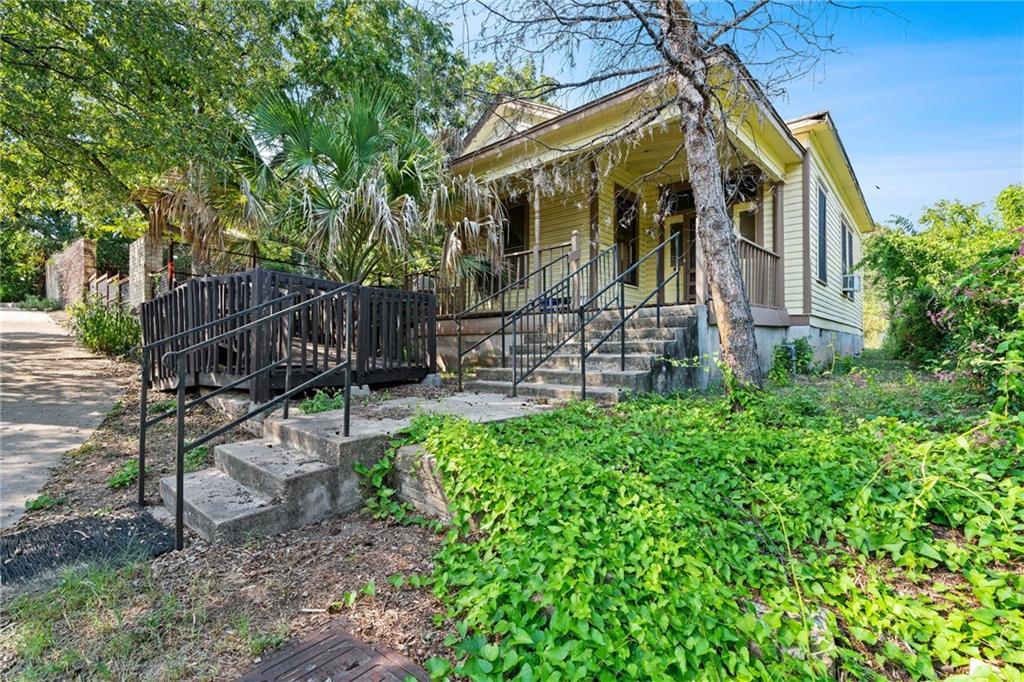 This is a rare opportunity to buy into one of Austin's newly established historical districts, the Robertson/Stuart & Mair Historic District, with buildings dating back to 1840. East 8th Street is a very walkable location, with many establishments within a short walk, like Zilker Brewing Company, The Liberty Bar, VIA313 Pizzeria, Ramen Tatsuya, The Grackle, Shangri-La, Violet Crown Social Club, The Lucky Duck, Low Down Lounge, The White House, Buenos Aires Café, Pangea Lounge food court, Ah Sing Den, and many more.  You can walk to Austin's central business district in less than 10 minutes. This home needs a lot of TLC and your vision to bring it back to its historic glory, but once complete you'll have an envious location you won't want to leave.  Buyers are purchasing the home and all contents as-is, where-is, the sellers, as heirs to the estate, have very little knowledge of the condition of the home.