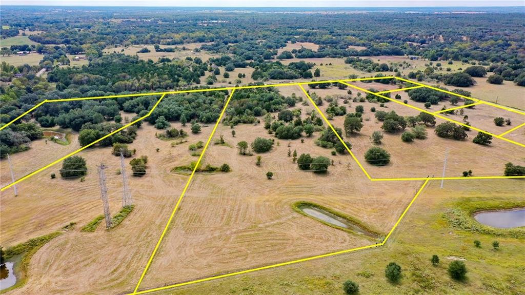 Rare 10.131 acres ready for you to build or bring in your dream home! This lot is fully fenced with a new driveway, gate, culvert, electricity at the road and stunning, mature trees. Seller to drill water well or supply a $10k credit for a water well at closing. Double wide manufactured homes in new or like-new condition are allowed! Seller financing offered with as little as 10% down. Only minutes to Smithville and a very short drive to Giddings, Bastrop and La Grange. Less than a 45 minute drive to the new Tesla factory and the Austin airport, and 50 minutes to Downtown Austin! This land is perfect for peaceful country living with an easy commute! There are tons of activities in the area such as: hiking, biking, kayaking, fishing or boating in Bastrop, Somerville or Fayette lakes, camping in 2 State parks, and much more! Bring your livestock and start enjoying the easy-going country life. This property is currently ag exempt. Some light restrictions apply to protect property values. For further info see posted docs. Other adjacent lots are also available. Do not miss this opportunity - make an appointment to come check it out today! You'll love it!